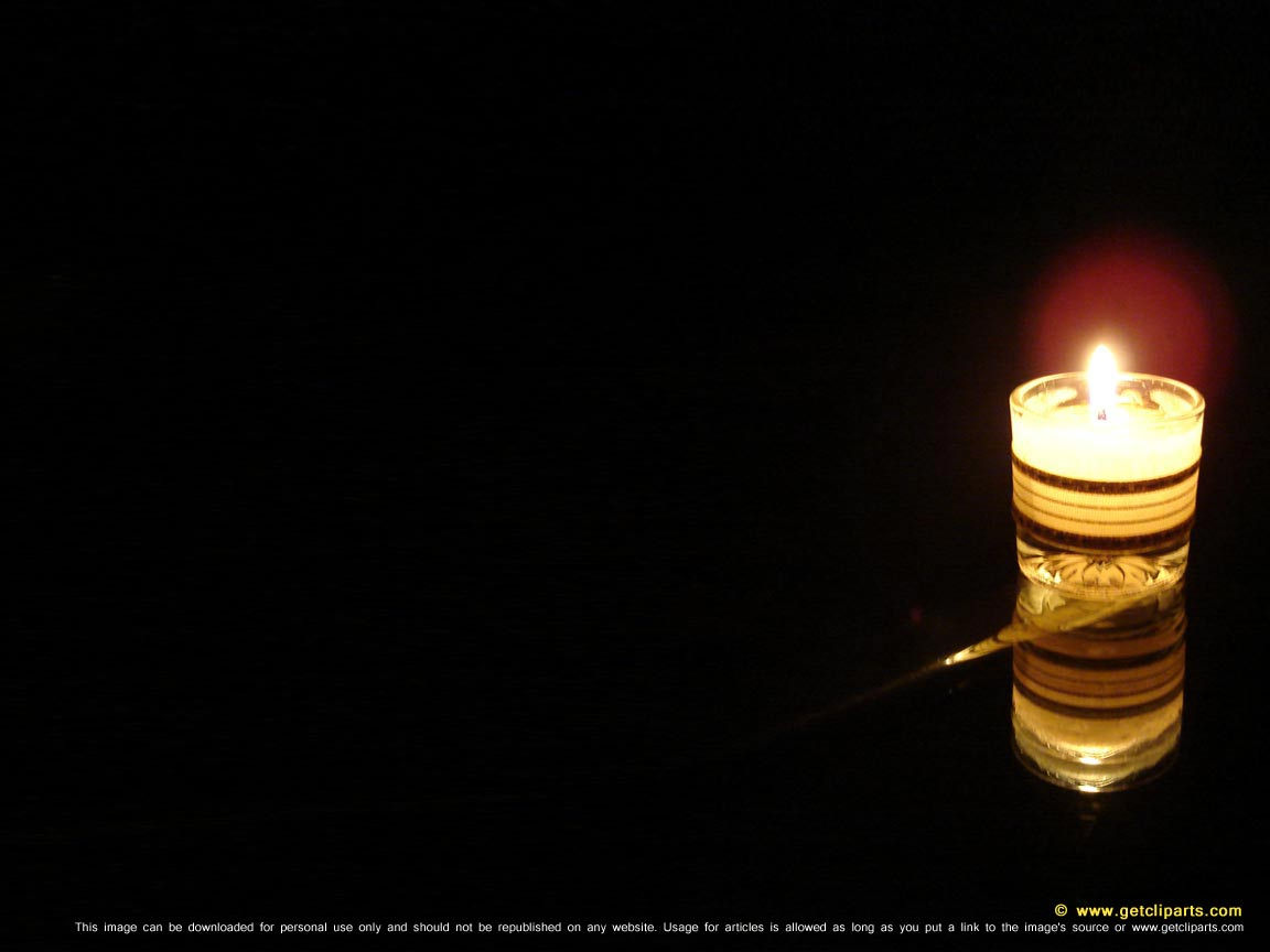 Candle light in black background for powerpoint and desktop wallpaper